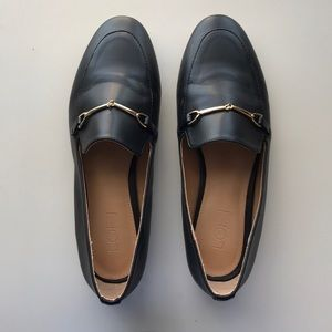 Black flats with gold buckle